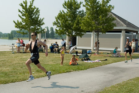 Stephen McKenna sprinting to the finish line at Maumee Bay Triathlon